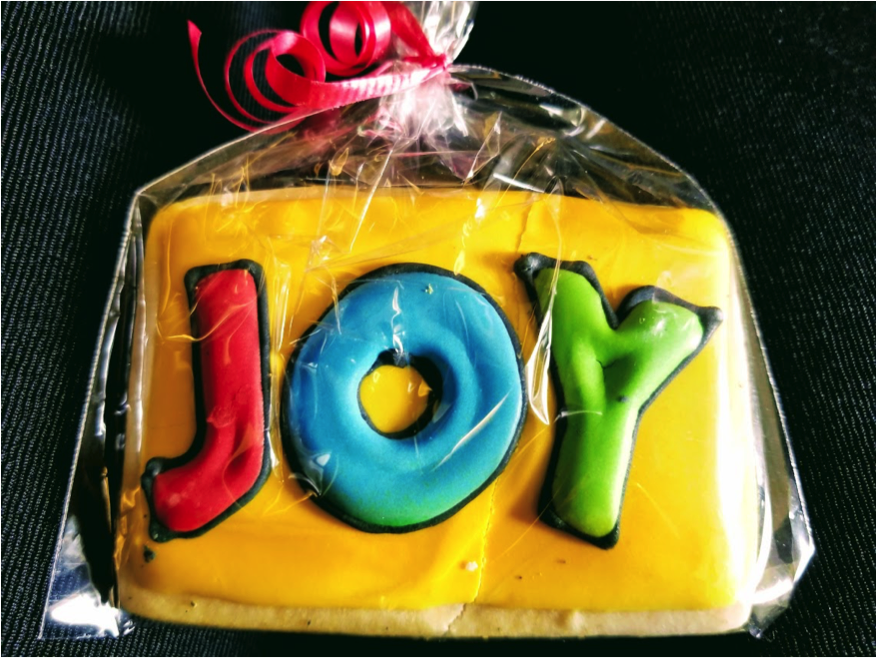cookie with words JOY on it