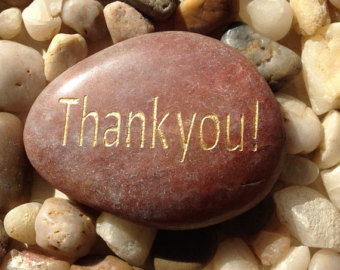 rock with Thank You on it